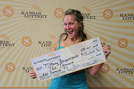 Tiffany Bergonzoni won $10,000 on the $20 Diamond 7's instant scratch game.